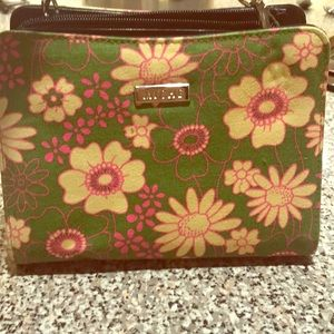 Niche purse with straps and floral shell.